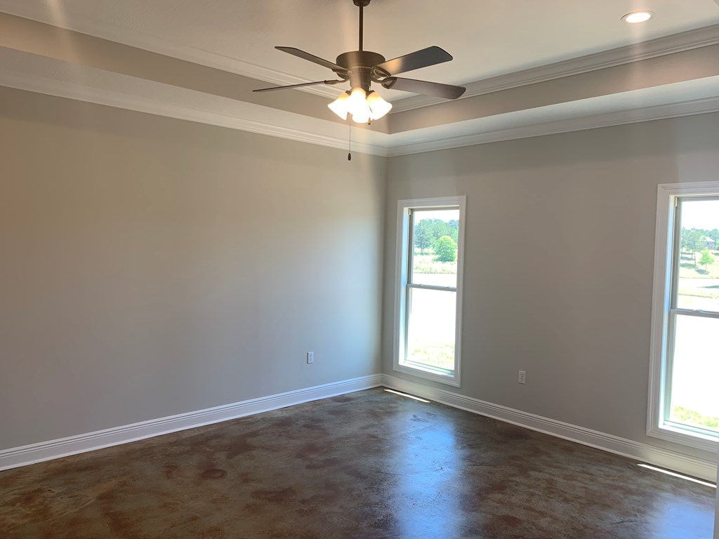 Master bedroom has  tray ceiling.