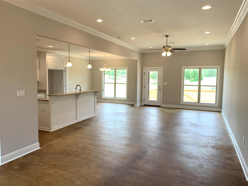Stained concrete flooring throughout